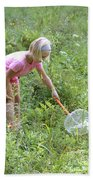 Girl Collects Insects In A Meadow Beach Towel by Ted Kinsman