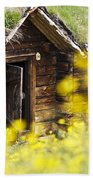 House Behind Yellow Flowers Beach Towel
