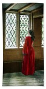 Lady In Tudor Gown Looking Out A Window Beach Sheet