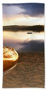 Lake Sunset With Canoe On Beach Beach Towel by Elena Elisseeva