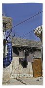 Laundry Hangs In The Courtyard Beach Towel by Stocktrek Images