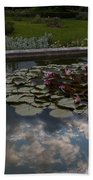 Lillies And Clouds Beach Towel