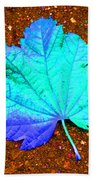 Maple Leaf On Pavement Beach Towel