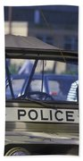 Military Policeman Stands Next Beach Towel by Michael Wood