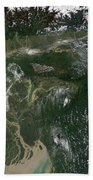 Monsoon Floods Beach Towel by NASA / Science Source