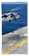 N Mh-60s Sea Hawk Helicopter Lifts Beach Towel