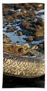 Need A Tire Beach Towel by Henrik Lehnerer