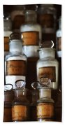 old pharmacy 2 - Old glass bottle with medicine powder of xviii century Beach Towel