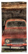 Old Red Car In A Wood Garage Beach Towel