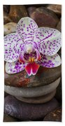 Orchid On Stack Of Rocks Beach Towel