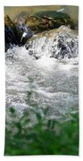 Over The Stones The Water Flows Beach Towel