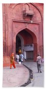 People Entering The Entrance Gate To The Red Colored Red Fort In New Delhi In India Beach Towel