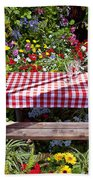 Picnic Table Among The Flowers Beach Towel