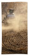 Plowing The Ground Beach Towel by Mike  Dawson