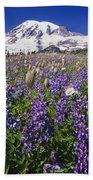 Purple Flowers Blooming Beneath Mount Beach Towel