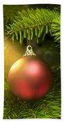 Red Ball In A Real Caucasian Fir Christmas Tree Beach Towel