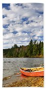 Red Canoe On Lake Shore Beach Towel