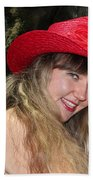 Red Hat And A Blonde Beach Sheet