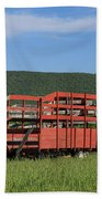 Red Hay Wagon In Green Mountain Field Beach Towel