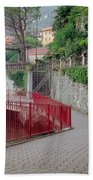 Red Rail Walkway To Varenna Along Lake Como Beach Towel