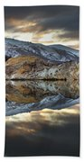 Reflections Of Cliffs On Blue Lake St Bathans Beach Towel by Colin Monteath