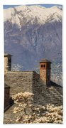 Roof With Chimney And Snow-capped Mountain Beach Towel