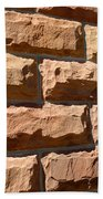Rough Hewn Sandstone Brick Wall Of A Historic Building Beach Towel