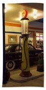 Route 66 Garage At Night Beach Towel