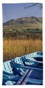 Row Boat Amongst Reeds On A Lake Beach Towel