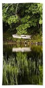 Rowboat Moored On The Bank Of A Lake Beach Towel