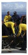 Sailors Prepare Pallets Of Cargo Aboard Beach Towel