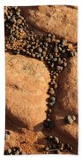 Sandstone And Pebbles Beach Towel by Gary Whitton