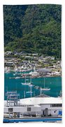 Small Idyllic Yacht Harbor  Beach Towel