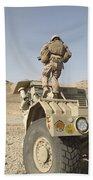 Soldier Climbs A Damaged Husky Tactical Beach Towel by Stocktrek Images