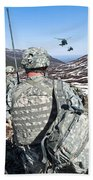 Soldiers Wait For Uh-60 Black Hawk Beach Towel