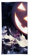 Spooky Jack-o-lantern On Fallen Leaves Beach Towel