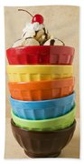 Stack Of Colored Bowls With Ice Cream On Top Beach Towel