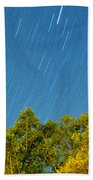 Star Trails On A Blue Sky Beach Towel