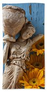 Statue Of Woman With Sunflowers Beach Towel