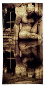 stone in reflexion - Statue reflected in a sea of doubt in vintage process Beach Towel