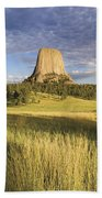 Sunset On Devils Tower Wyoming United Beach Towel