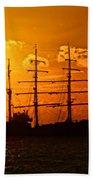Tall Ship At Sunset Beach Towel