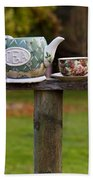 Teapot And Tea Cup On Old Post Beach Sheet