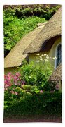 Thatched Cottage With Pink Flowers Beach Towel