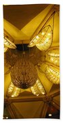 The Beautifully Lit Chandelier On The Ceiling Of The Iskcon Temple In Delhi Beach Towel