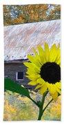 The Sunflower And The Barn Beach Towel