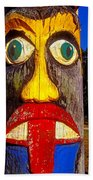 Totem Pole With Tongue Sticking Out Beach Towel