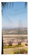 Tree Blocking View Of Garden And Valley And Ice-capped Mountains Beach Towel