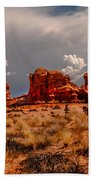 Turret Arch And Storm Clouds Beach Towel