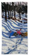 Two Boys Falling Off A Sledge Beach Towel by Andrew Macara